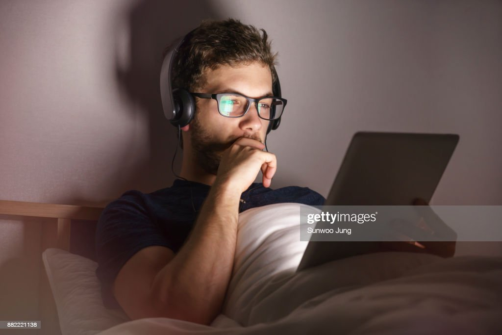 Man with tablet working late at home : Stock Photo