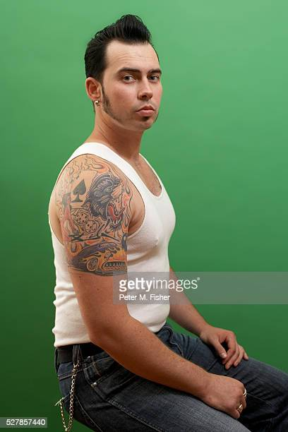 Man with Tattoo and Pompadour