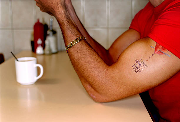 Man with tattoo in cafe