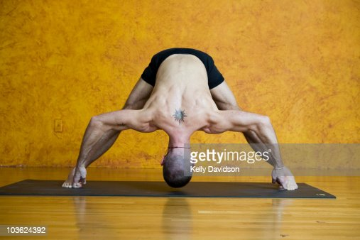 Man With Tattoo In Yoga Pose High Res Stock Photo Getty Images