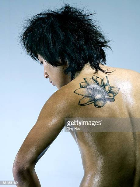 Man with tattoo on back, rear view