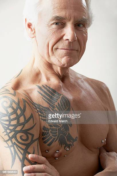 Man with tattoos and nipple rings