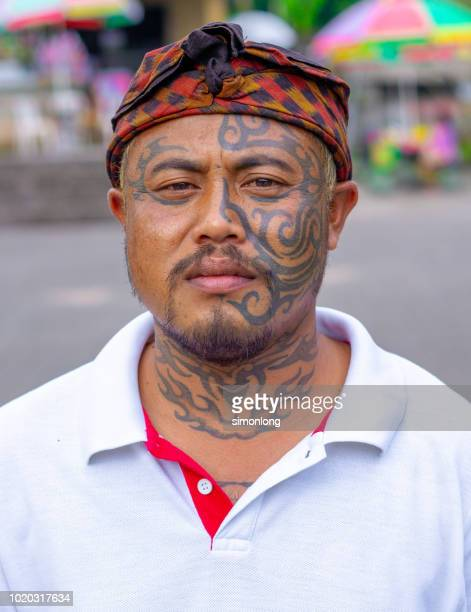 man with tattoos - indonesian culture stock pictures, royalty-free photos & images