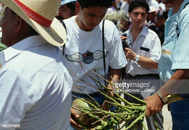 A man with the gifts he received during the celebrations at the Guelaguetza festival Oaxaca Mexico