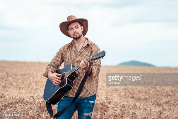 man with the guitar - folk music stock pictures, royalty-free photos & images