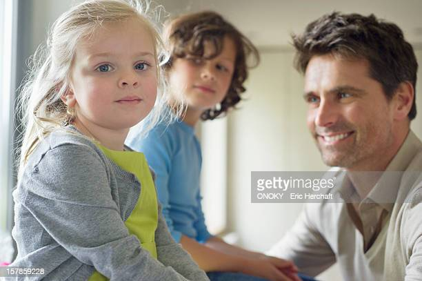 Man with their children at home