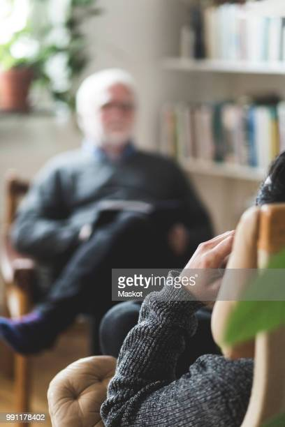 man with therapist in home office - overworked stock pictures, royalty-free photos & images