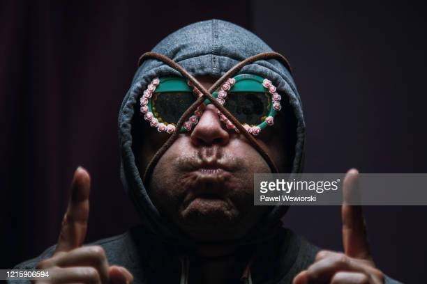 man with thong string and funny sunglasses on his face - fashion oddities stock pictures, royalty-free photos & images