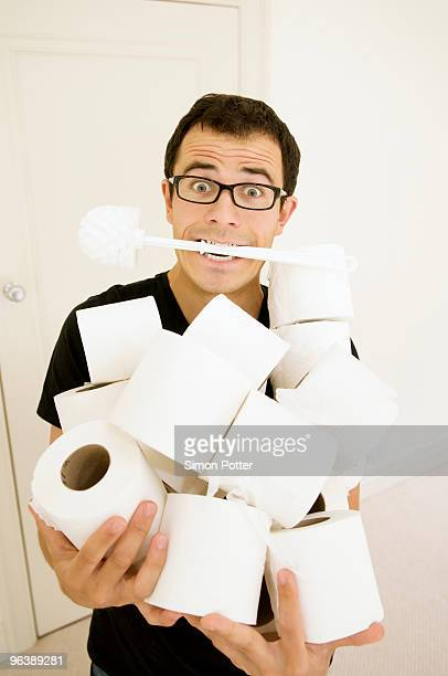 man with toilet brush and toilet rolls - funny toilet paper stock pictures, royalty-free photos & images