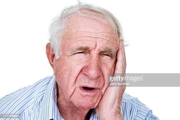 man with toothache or receiver of bad news - wit haar stockfoto's en -beelden