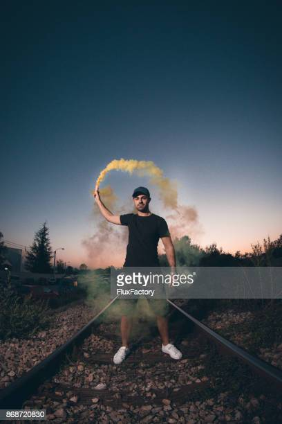 Man with torch on railway track