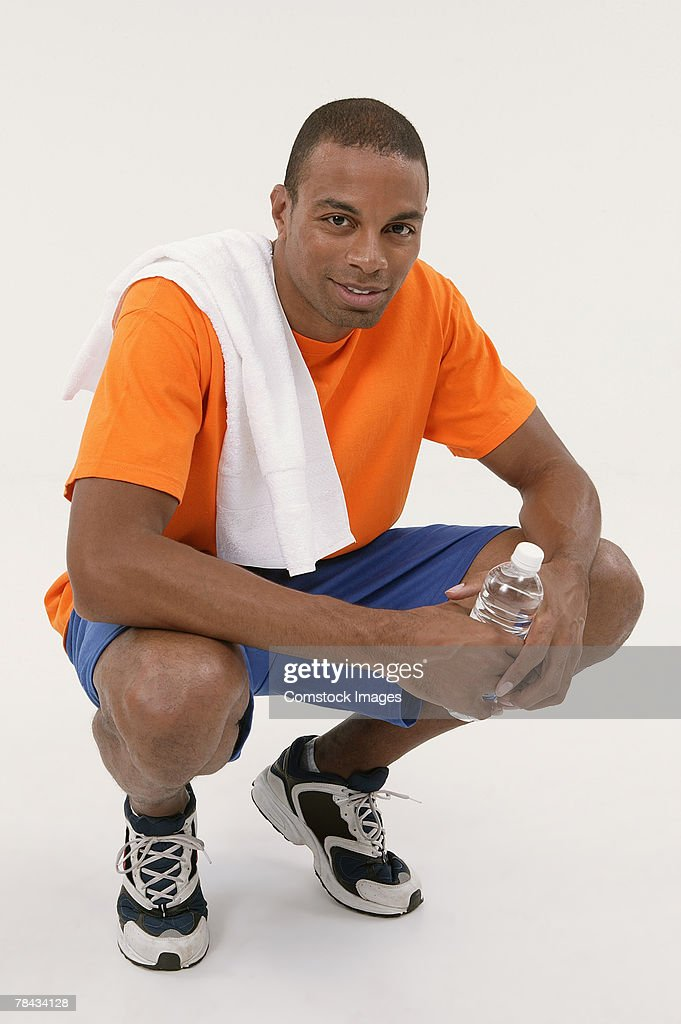 Man with towel and water bottle : Stockfoto