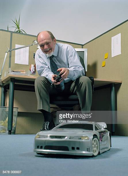 man with toy automobile - remote controlled car stock pictures, royalty-free photos & images