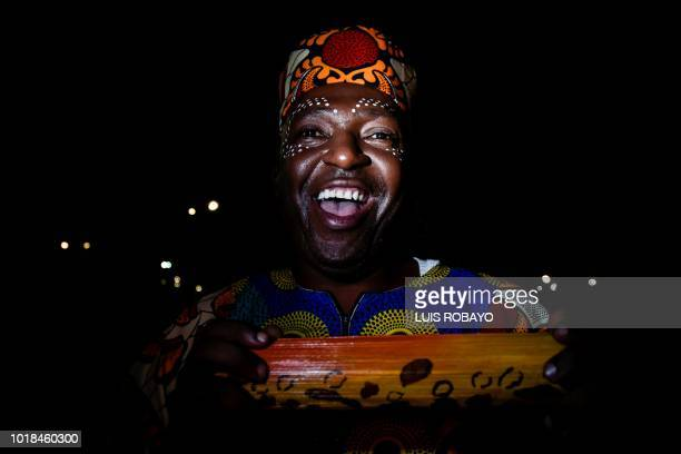 A man with traditional face paint dances during the XXII Petronio Alvarez Pacific Music Festival in Cali Colombia on August 17 2018 The Petronio...
