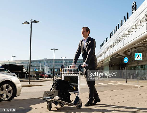 Man with trolley at parking lot