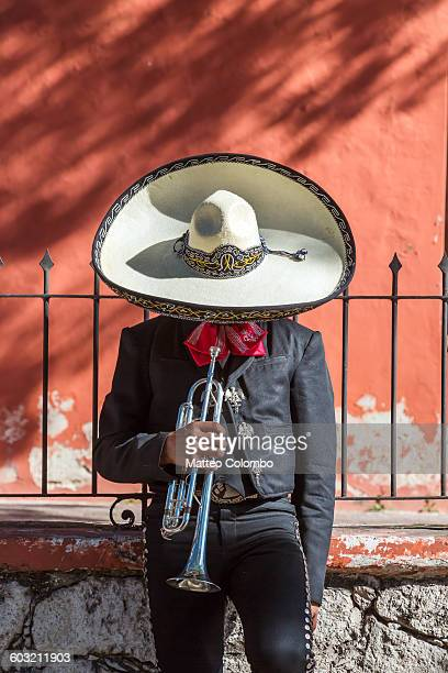 man with trumpet from mariachi group, mexico - mexique photos et images de collection
