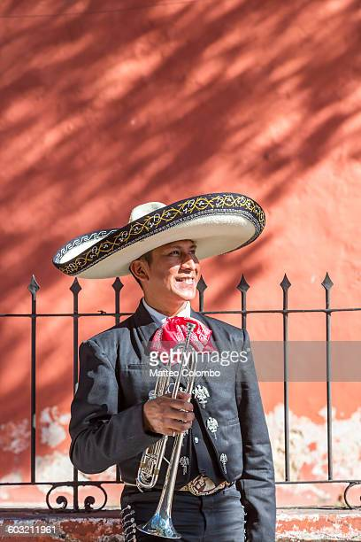 man with trumpet from mariachi group, mexico - merida mexico stock photos and pictures