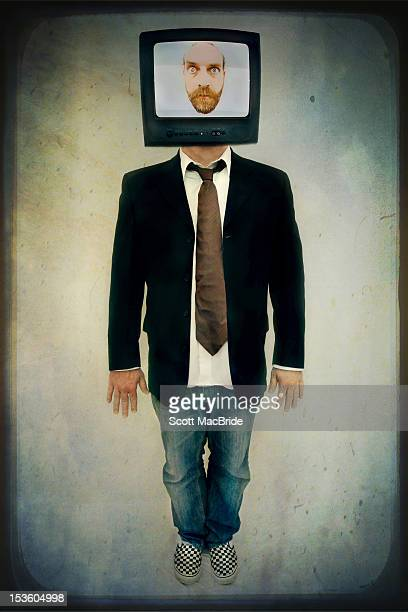man with tv on face - scott macbride stock pictures, royalty-free photos & images