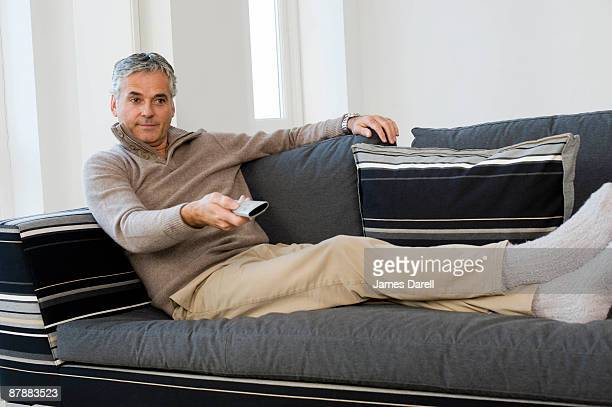 Man with TV remote