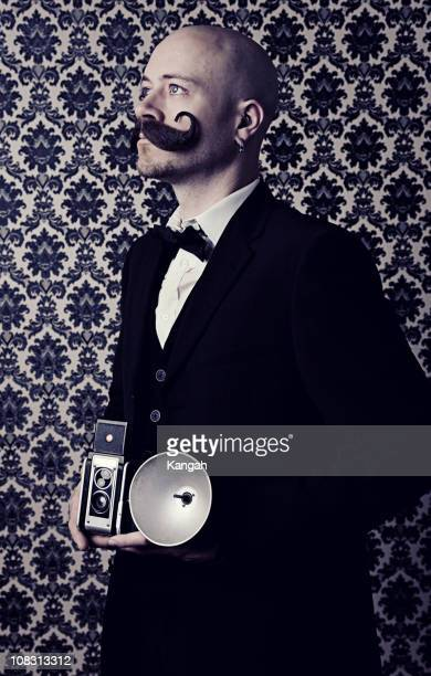man with vintage camera - blad stock pictures, royalty-free photos & images
