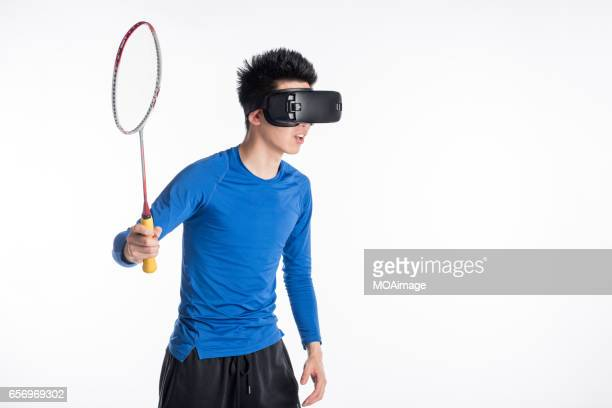 man with virtual reality goggles - badminton sport stock photos and pictures