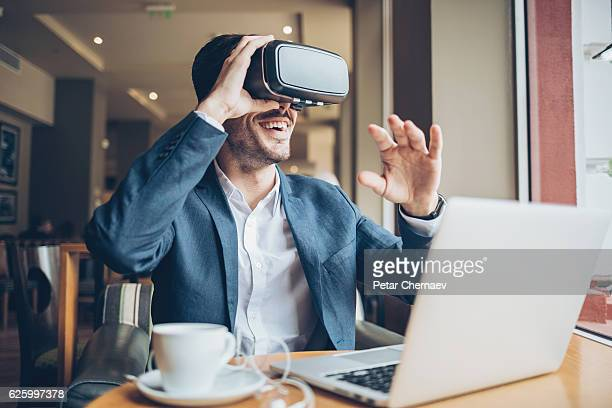 man with virtual reality headset - redoubtable film stock photos and pictures