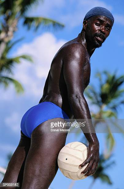 man with volleyball - black men in speedos stock photos and pictures