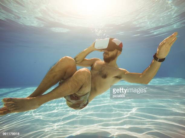 Man with Vr headset sensory experience underwater