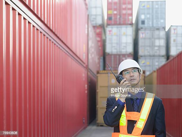 man with walkie talkie - shipyard stock pictures, royalty-free photos & images