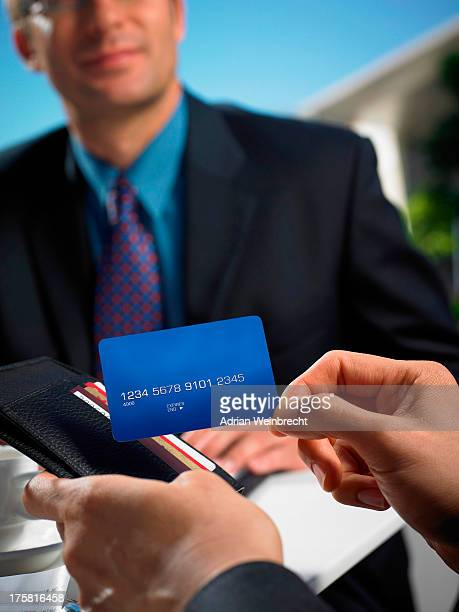 Man with wallet making credit card payment