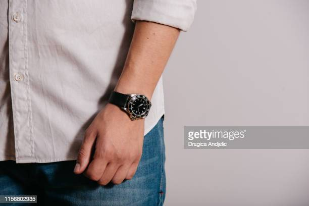 man with watch. - wrist stock pictures, royalty-free photos & images