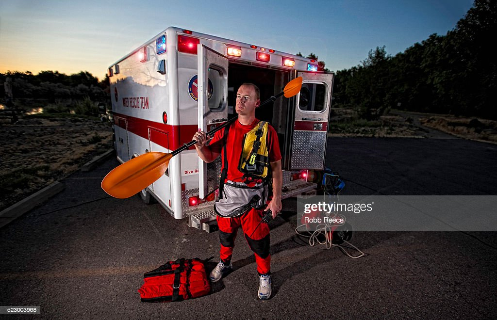 Man with water rescue equipment and ambulance, Grand Junction, Colorado, USA : Stock Photo