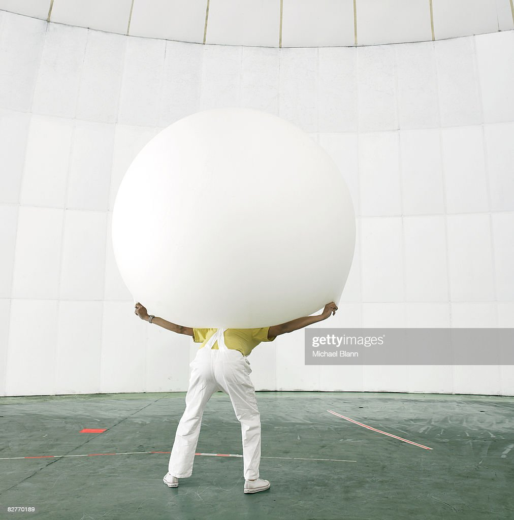 Man with weight on shoulders : Stock Photo