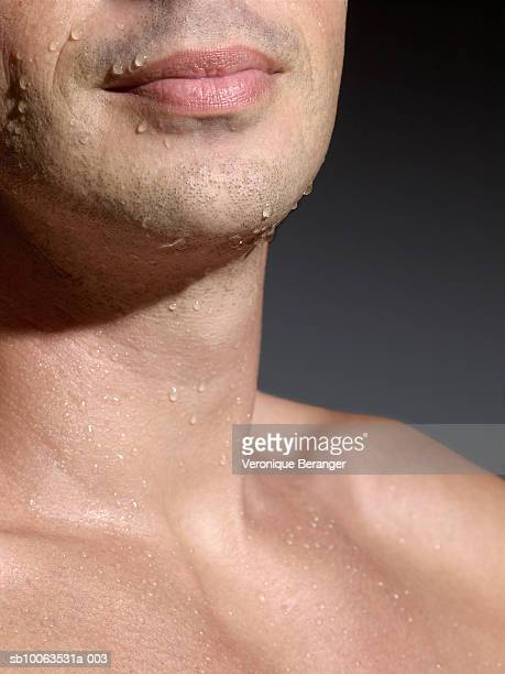 man with wet bare chest, mid section, close-up - chest barechested bare chested fotografías e imágenes de stock