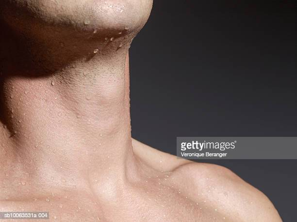 Man with wet bare chest, mid section, close-up