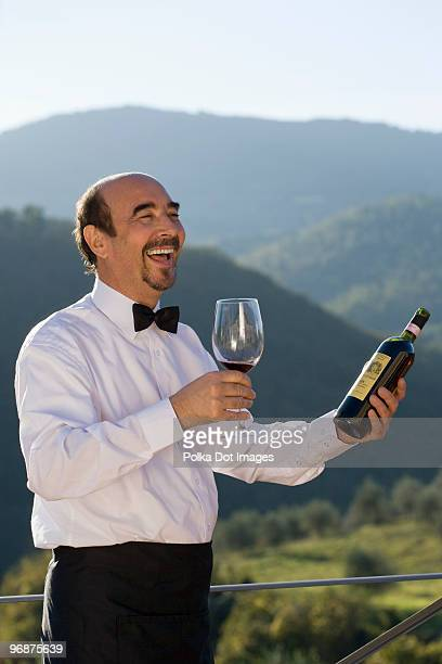 Man with wine bottle and glass
