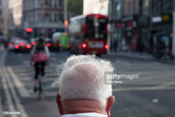 Man with wispy white thinning hair in London United Kingdom