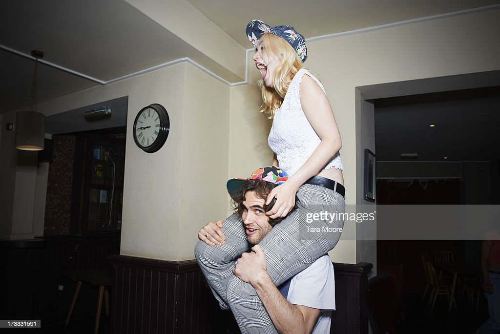 man with woman on shoulders having fun : Stock Photo