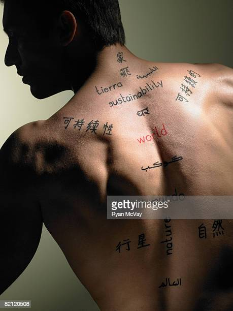man with words written on body