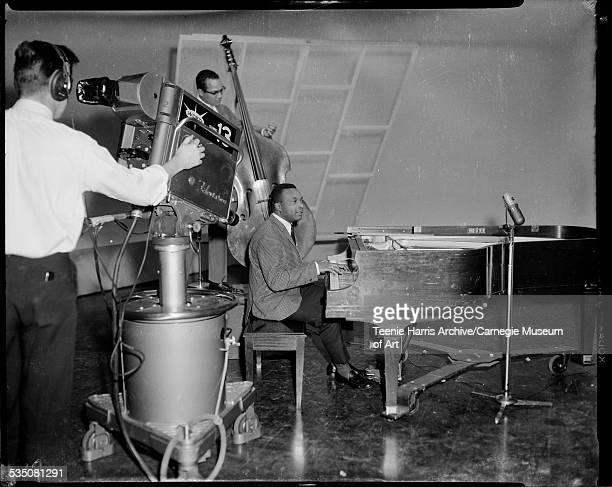 Man with WQED channel 13 television camera filming Walt Harper on piano and Bobby Boswell on bass in studio Pittsburgh Pennsylvania 1958