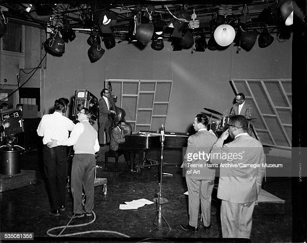 Man with WQED Channel 13 television camera filming Walt Harper on piano Bobby Boswell on bass and Bert Logan Jr on drums with Jon Morris and Nate...