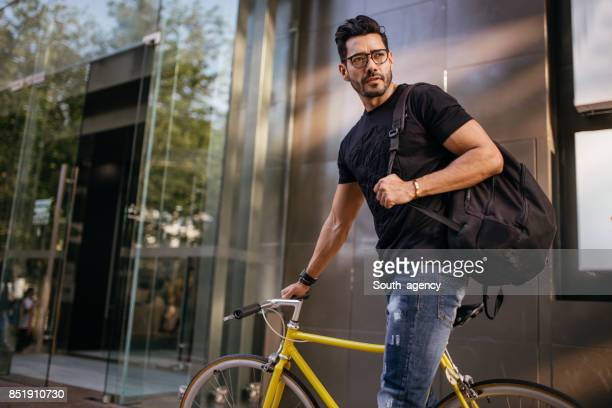 Man with yellow bicycle
