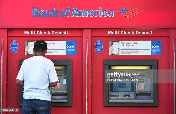 A man withdraws cash from a Bank of America automated teller machine in Hollywood on October 24 2012 in California The United States has sued Bank of...