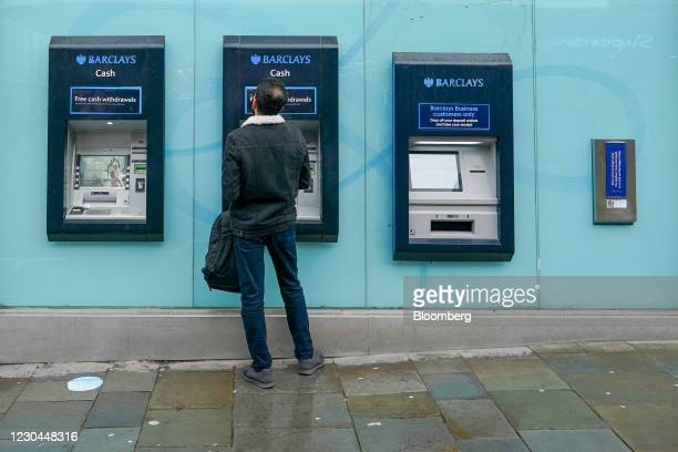 Man withdraws money from an automated teller machine ATM at Barclays Plc bank branch in Newcastle, U.K., on Wednesday, Jan. 6, 2021. U.K. Businesses...