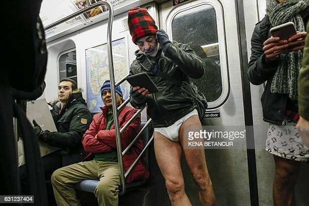 Man without pants travels in a subway during the 'No Pants Subway Ride' in New York on January 8, 2017. The event, which first took place in New York...