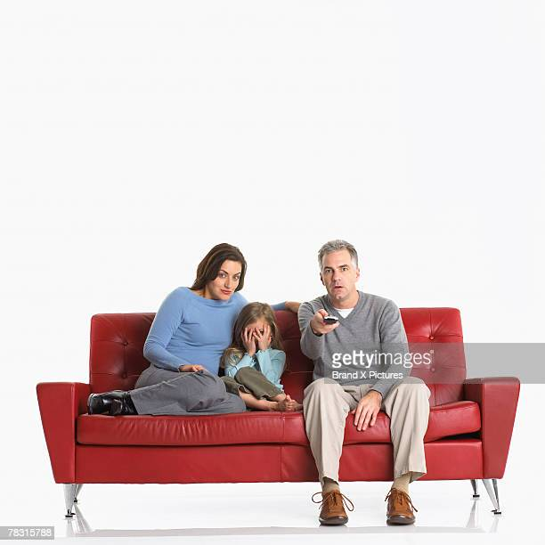 Man woman and girl watching television