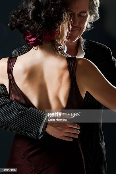 man & woman dancing tango