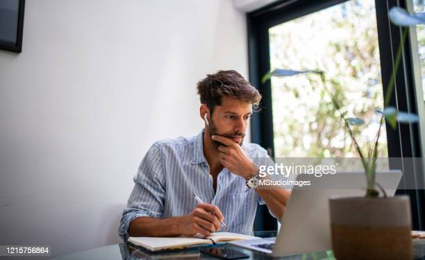 man woriking from home. - using laptop stock pictures, royalty-free photos & images