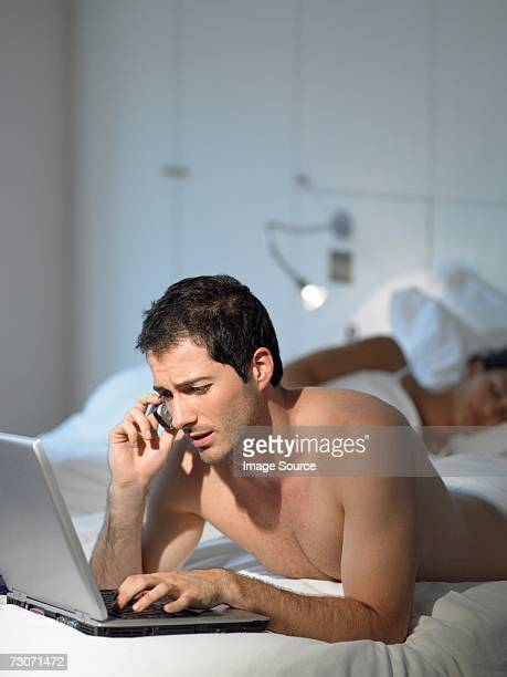 Man working as wife sleeps
