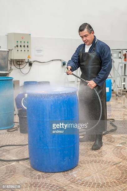 man working at a chemical factory - drum container stock photos and pictures